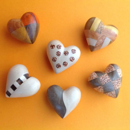 SET OF SIX GERMAN WOODEN HEARTS