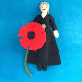 FELT GEORGIA O'KEEFFE WITH A RED POPPY FELT ORNAMENT BY LEAH KOSTOPLOS