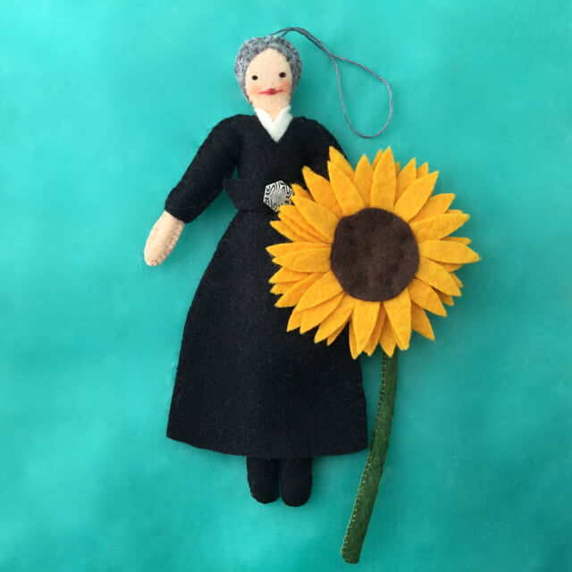 FELT GEORGIA O'KEEFFE WITH A YELLOW SUNFLOWER FELT ORNAMENT BY LEAH KOSTOPLOS