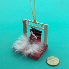 MINIATURE NAVAJO WEAVER ORNAMENT
